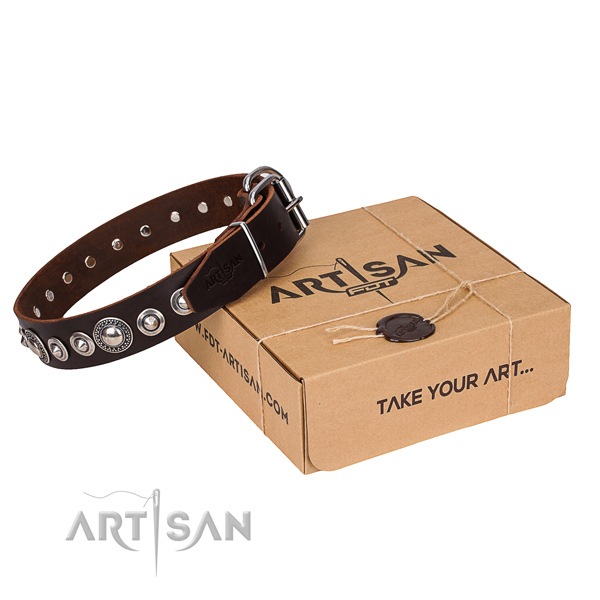 Leather dog collar made of soft to touch material with rust resistant traditional buckle